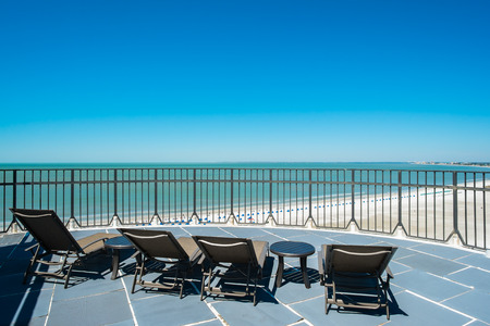 penthouse: Lounge chairs on a rooftop penthouse apartment in the Florida west coast. Stock Photo