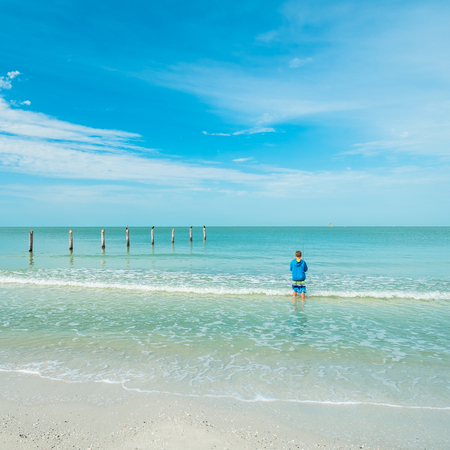 Young teenager fishing on a popular Florida beach  photo
