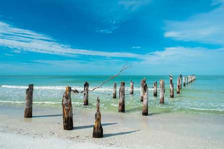 myers: Rustic decaying pier along Fort Myers Beach on the west coast of Florida
