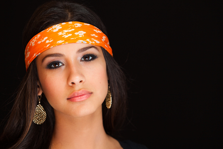 Beautiful young woman on a black background. photo