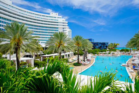 MIAMI BEACH, FLORIDA USA APRIL 21, 2013: The historic Fontainebleau Hotel by architect Morris Lapidus on Miami Beach is a popular international tourist destination.