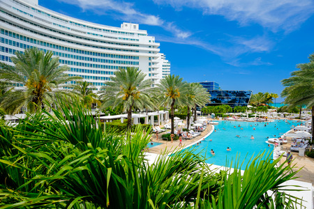 morris: MIAMI BEACH, FLORIDA USA APRIL 21, 2013: The historic Fontainebleau Hotel by architect Morris Lapidus on Miami Beach is a popular international tourist destination.
