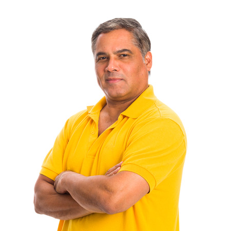 brown skin: Handsome middle age hispanic man in a studio portrait on a white background.