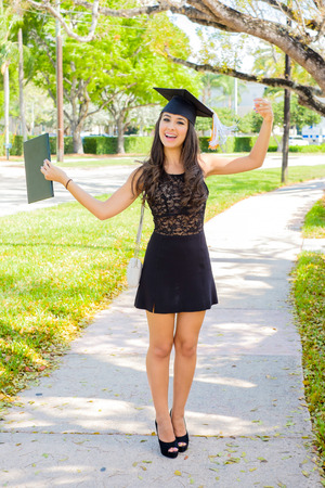 middle eastern ethnicity: Beautiful young woman celebrating her college graduation.