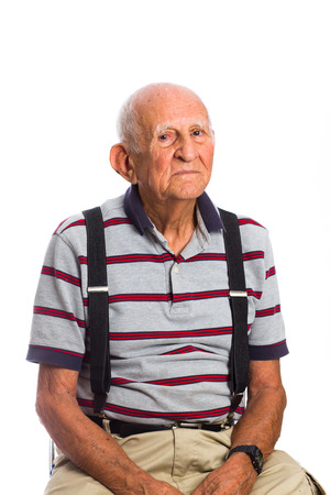 eighty: Elderly eighty plus year old man in a studio portrait on a white background.