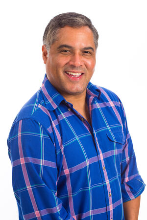 male age 40's: Handsome middle age hispanic man in a studio portrait on a white background.