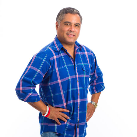 Handsome middle age hispanic man in a studio portrait on a white background.