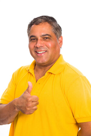 yellow shirt: Handsome middle age hispanic man in a studio portrait on a white background.