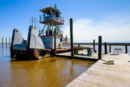 mississippi river: Tugboat docked along the shoreline in Mississippi. Stock Photo