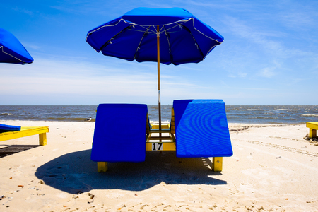 mississippi: Gulf coast beach in Biloxi, Mississippi with lounge chairs along the shoreline.
