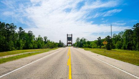 ninety: Two lane rural highway along Highway Ninety in Louisiana.