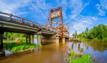 ninety: Vintage bridge over a rural river in Louisiana on Highway Ninety.