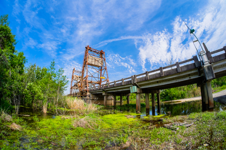 Vintage bridge over a rural river in Louisiana on Highway Ninety.