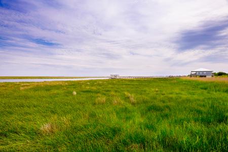 Long boathouse pier over marshland in rural Louisiana.