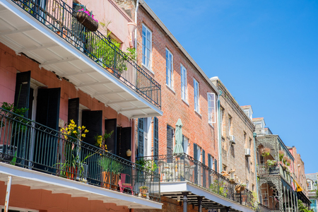 french doors: Colorful architecture in the French Quarter in New Orleans, Louisiana. Stock Photo
