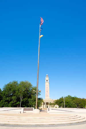 louisiana flag: BATON ROUGE, LOUISIANA USA - MAY 5,2014: The 175 foot Memorial Tower, or Campanile, located on the Louisiana State University campus was erected in 1923 is a memorial to Louisianans who died in World War I.