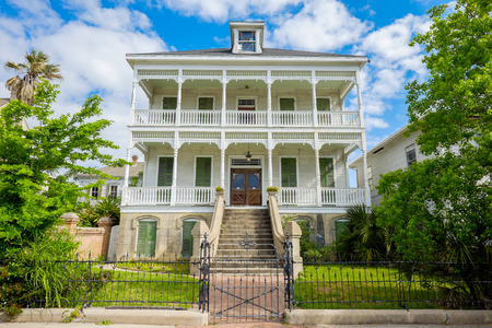 multi story: GALVESTON, TEXAS USA - MAY 6, 2014: The Silk Stocking Residential Historic District in Galveston contains beautifully restored vintage homes of the Queen Anne architecture style.