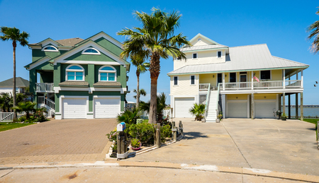 TIKI ISLAND, TEXAS USA - MAY 6, 2014: The village of Tiki Island, located on a small peninsula in Jones Bay in Galveston County, is a popular coastal community containing beautiful multi level waterfront homes.