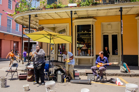 street musician: NEW ORLEANS, LOUISIANA USA - MAY 1, 2014: Unidentified street performers playing jazz style music in the French Quarter district in New Orleans, Louisiana.