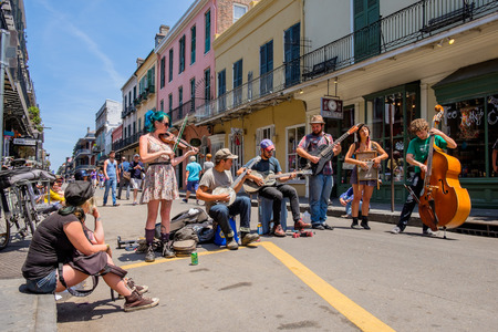 NEW ORLEANS, LOUISIANA USA - MAY 1, 2014: Unidentified street performers playing blue grass style music in the French Quarter district in New Orleans, Louisiana. Editorial
