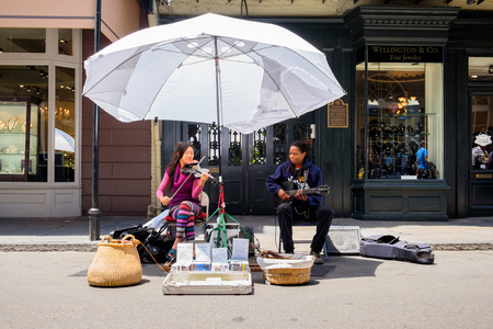 NEW ORLEANS, LOUISIANA USA - MAY 1, 2014: Unidentified street performers playing classical style music in the French Quarter district in New Orleans, Louisiana.