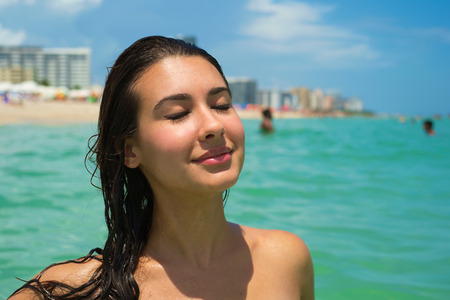 latin american ethnicity: Beautiful young multicultural woman enjoying the beach