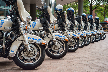 CHARLOTTE, NORTH CAROLINA USA - OCTOBER 10, 2013: Charlotte police department motorcycles lined up outside a municipal downtown building. Editorial