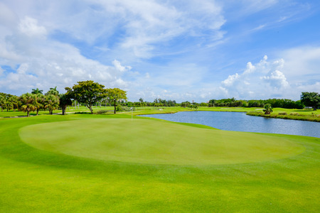 viewed: Golf course landscape viewed from behind the putting green. Stock Photo