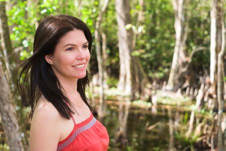 Beautiful woman enjoying the outdoors in the Florida Everglades. Stock Photo