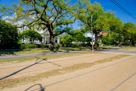 suburbs: Historical southern style homes along Saint Charles Avenue in New Orleans, Louisiana.