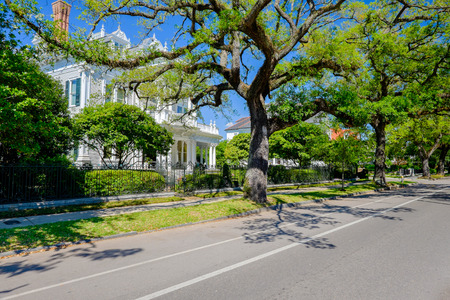 Historical southern style homes along Saint Charles Avenue in New Orleans, Louisiana.