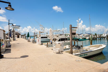 bight: KEY WEST, FLORIDA USA - JUNE 26, 2014: Charter boats available for hire at the Bight Marina in Key West.
