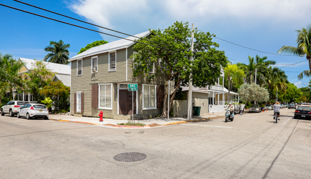 KEY WEST, FLORIDA USA - JUNE 26, 2014: A typical Key West street corner in the historical district with vintage homes.