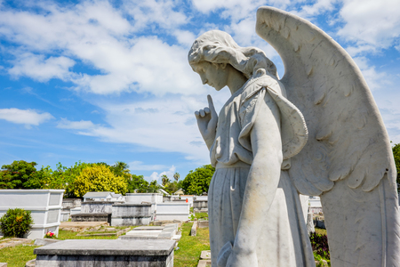 angel cemetery: KEY WEST, FLORIDA USA - JUNE 26, 2014: Angel statue in the Key West Cemetery in the Historic District founded in 1847.