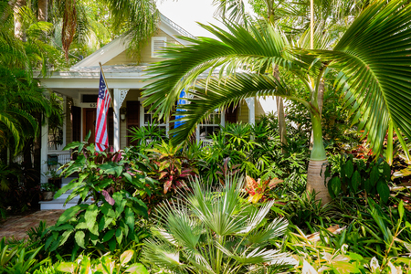 residential home: KEY WEST, FLORIDA USA - JUNE 26, 2014: A beautifully restored vintage home in the residential Historic District of Key West.