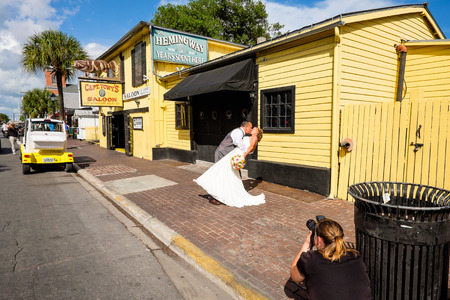 KEY WEST, FLORIDA USA - JUNE 26, 2014: A wedding party making a stop at the historic Captain Tonys Saloon in downtown Key West. Editorial