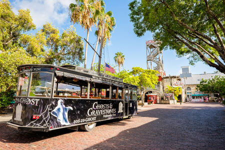 KEY WEST, FLORIDA USA - JUNE 26, 2014: The Ghosts and Gravestones tour is a popular tourist attraction in downtown Key West.