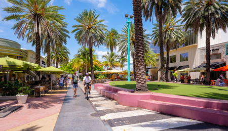 south beach: Miami Beach, Florida USA - August 1, 2014: The beautiful Lincoln Road Mall in Miami Beach is a popular international travel destination with palm trees and art deco architecture.