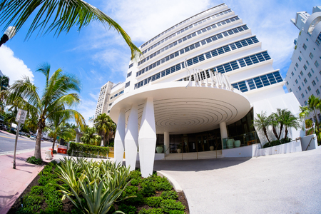 Miami Beach, Florida USA - August 1, 2014: The beautiful Shelborne Club Hotel in Miami Beach, a popular international travel destination, fish eye view with palm trees and art deco architecture.