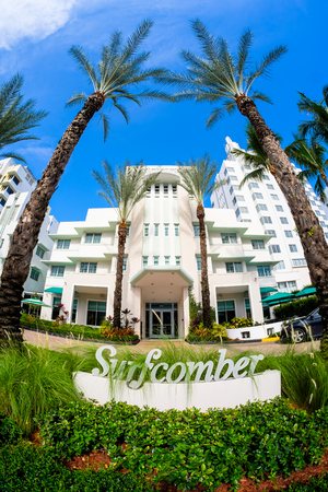 Miami Beach, Florida USA - August 1, 2014: The beautiful Surfcomber Hotel in Miami Beach, a popular international travel destination, fish eye view with palm trees and art deco architecture.