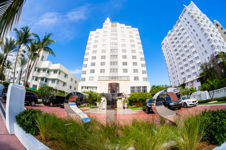 Miami Beach, Florida USA - August 1, 2014: The beautiful SLS Hotel in Miami Beach, a popular international travel destination, fish eye view with palm trees and art deco architecture.
