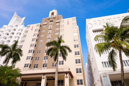 Miami Beach, Florida USA - August 1, 2014: The beautiful Art Deco hotels in Miami Beach are popular international travel destinations with palm trees and art deco architecture.