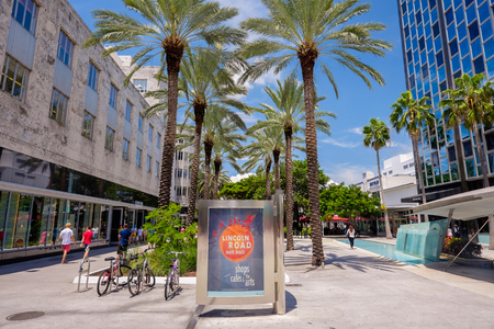 Miami Beach, Florida USA - August 1, 2014: The beautiful Lincoln Road Mall in Miami Beach is a popular international travel destination with palm trees and art deco architecture.