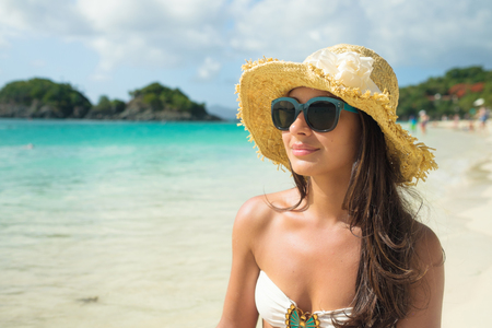 woman bathing: Beautiful young multicultural woman enjoying a Caribbean beach in Saint John in the United States Virgin Islands.