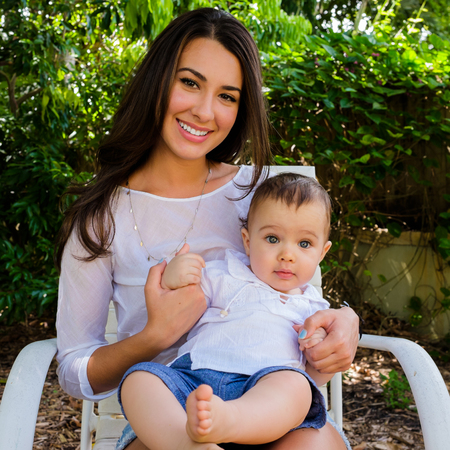 mixed race baby: Cute baby boy with pretty young woman outdoors.