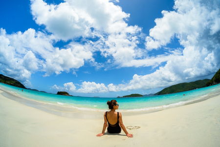 virgin: Pretty girl enjoying a beautiful Carribean beach in Saint John in the United States Virgin Islands. Stock Photo