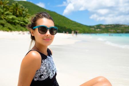 virgin girl: Pretty girl enjoying a beautiful Carribean beach in Saint John in the United States Virgin Islands. Stock Photo