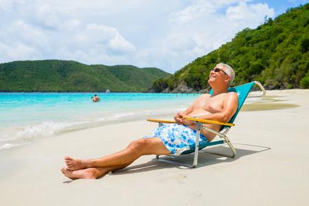 sex appeal: Handsome middle age man enjoying a Caribbean beach in Saint John.