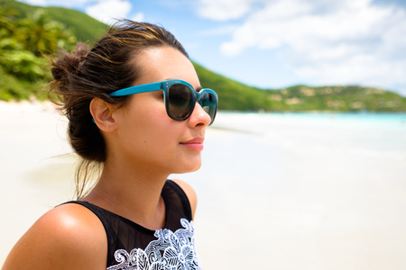Pretty girl enjoying a beautiful Carribean beach in Saint John in the United States Virgin Islands. Stock Photo