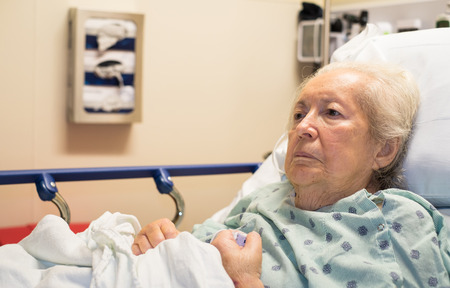 Elderly eighty plus year old woman in a hospital bed.